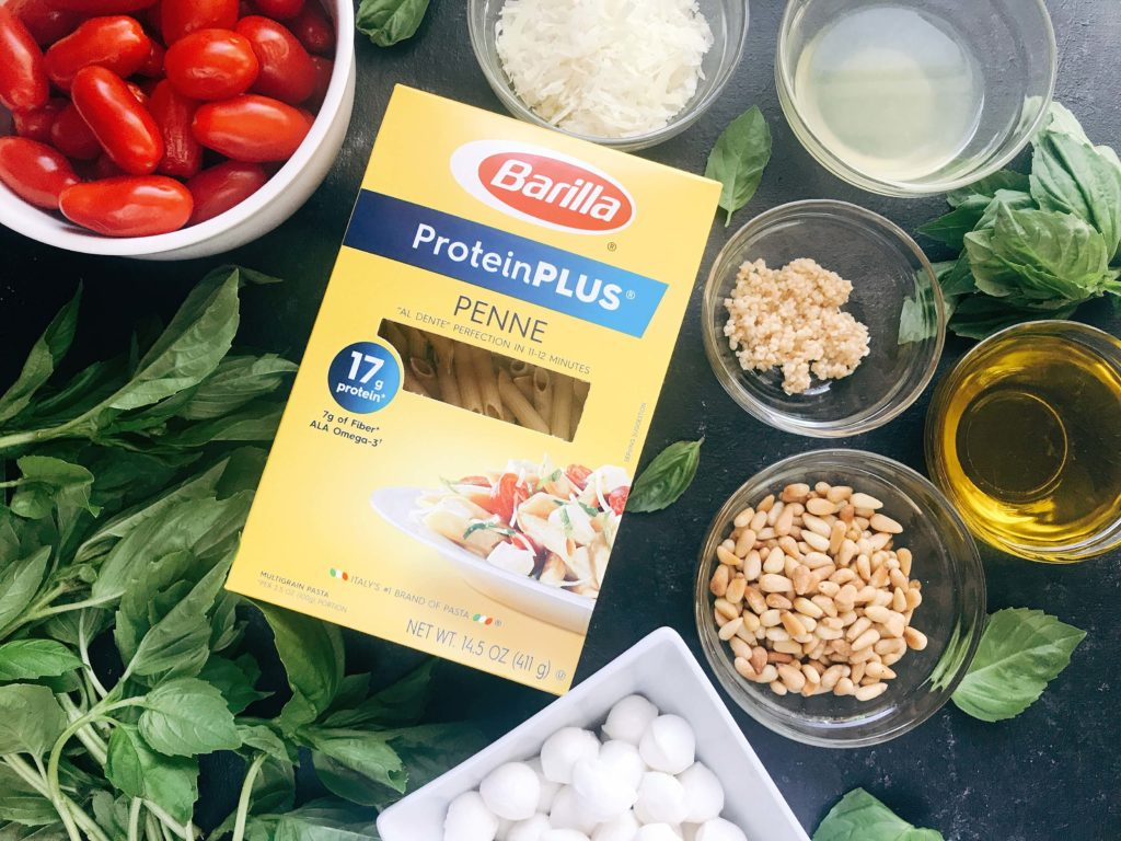 Less than 25 minutes to make this fresh basil pesto pasta with cherry tomatoes and fresh mozzarella cheese. A quick and simple Italian pasta recipe highlighting fresh caprese flavors. Vegetarian recipe but add chicken or sausage for the meat lovers. Featuring Barilla ProteinPLUS pasta, this dinner recipe is nutritious and hearty, packed with protein, fiber, and Omega-3. Pesto Caprese Penne Pasta | Three Olives Branch | www.threeolivesbranch.com