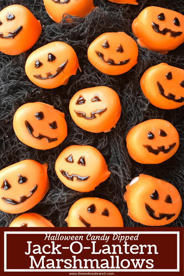 Candy pumpkin marshmallows, perfect for Halloween! Marshmallows are coated in melted orange candy with black piping gel for their jack-o-lantern faces. A fun dessert treat to make for Halloween parties. Halloween Candy Dipped Jack-O-Lantern Pumpkin Marshmallows | Three Olives Branch | www.threeolivesbranch.com #halloween #marshmallow #pumpkin #jackolantern