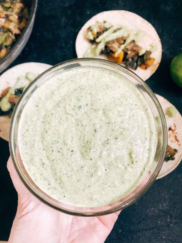 Quick and simple crema recipe for Mexican foods. Roasted poblano peppers are blended with lime juice and sour cream for a fast and easy sauce. Vegetarian, low carb keto, and gluten free recipe. Roasted Poblano Lime Crema #poblanosauce #tacosauce #mexicansauce