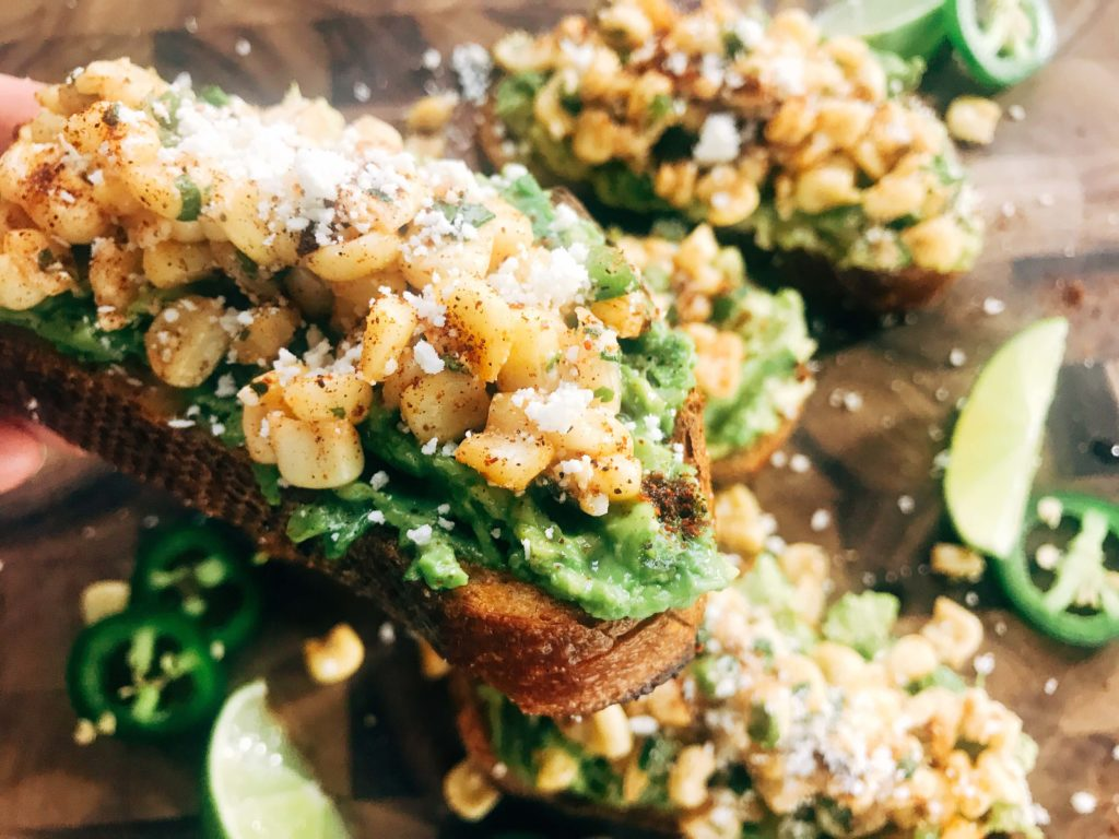 Fast and simple avocado toast topped with Mexican Street Corn Salsa. Quick breakfast, lunch, or snack recipe. Elote flavors of corn, cotija, chili powder, lime, cilantro, and jalapeno make a flavorful salsa. Vegetarian. Mexican Street Corn Avocado Toast | Three Olives Branch | www.threeolivesbranch.com