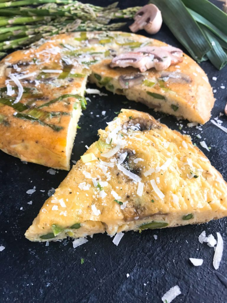 A quick and simple breakfast or brunch recipe ready in 20 minutes. Vegetarian, low carb keto, and gluten free, this frittata is similar to an omelette and perfect for holidays like Easter and feeding a crowd. Asparagus, Leek, and Mushroom Parmesan Frittata #breakfastrecipe #vegetarianbreakfast #easterbrunch #springbreakfast