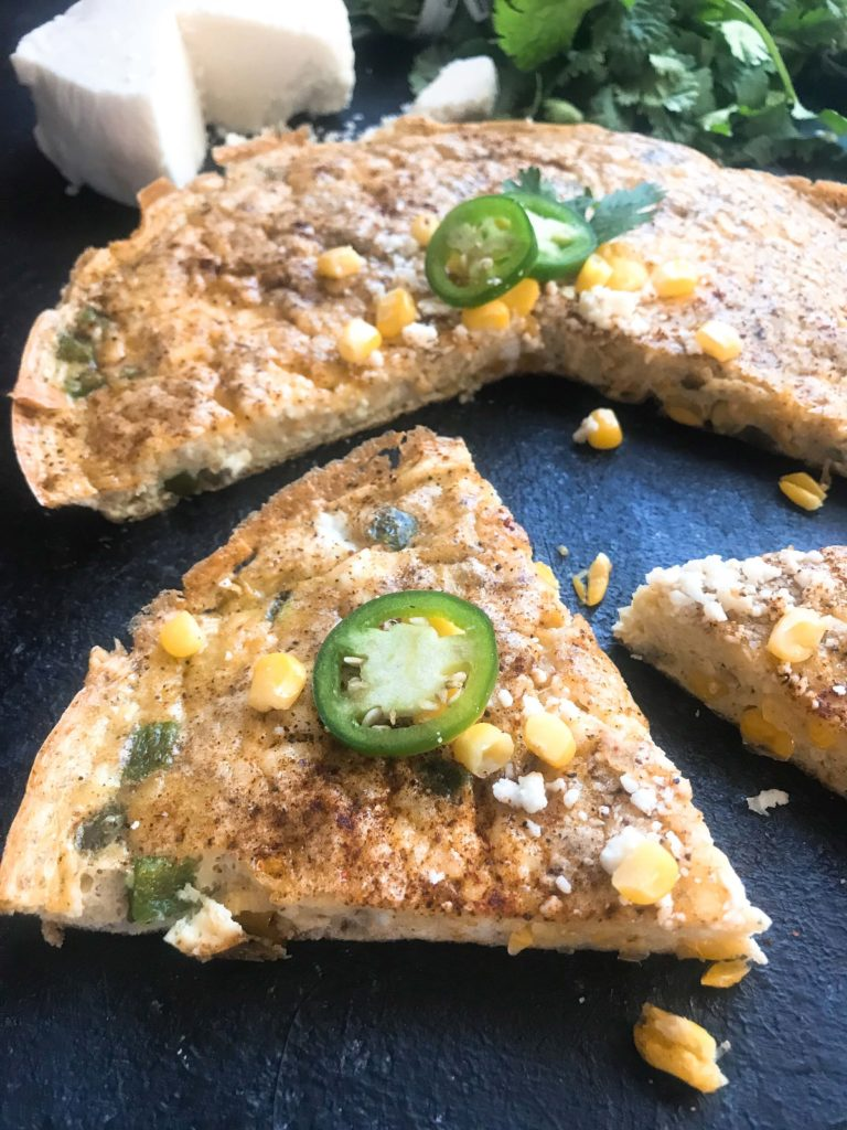 Ready in 20 minutes, this gluten free and vegetarian frittata is a quick and simple breakfast or brunch. Perfect for hosting and holidays, the classic flavors of Mexican Street Corn (elote) are combined in this egg dish. Mexican Street Corn Frittata | Three Olives Branch | www.threeolivesbranch.com #easterbrunch #breakfast #frittata