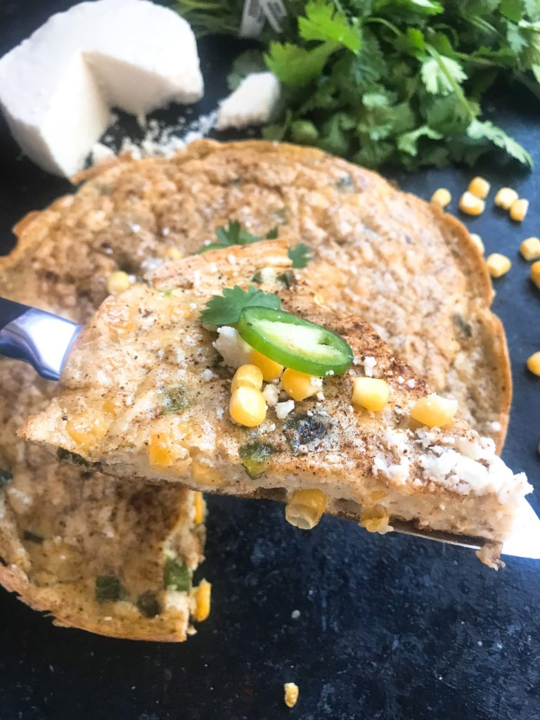 Ready in 20 minutes, this gluten free and vegetarian frittata is a quick and simple breakfast or brunch. Perfect for hosting and holidays, the classic flavors of Mexican Street Corn (elote) are combined in this egg dish. Mexican Street Corn Frittata   Three Olives Branch   www.threeolivesbranch.com #easterbrunch #breakfast #frittata