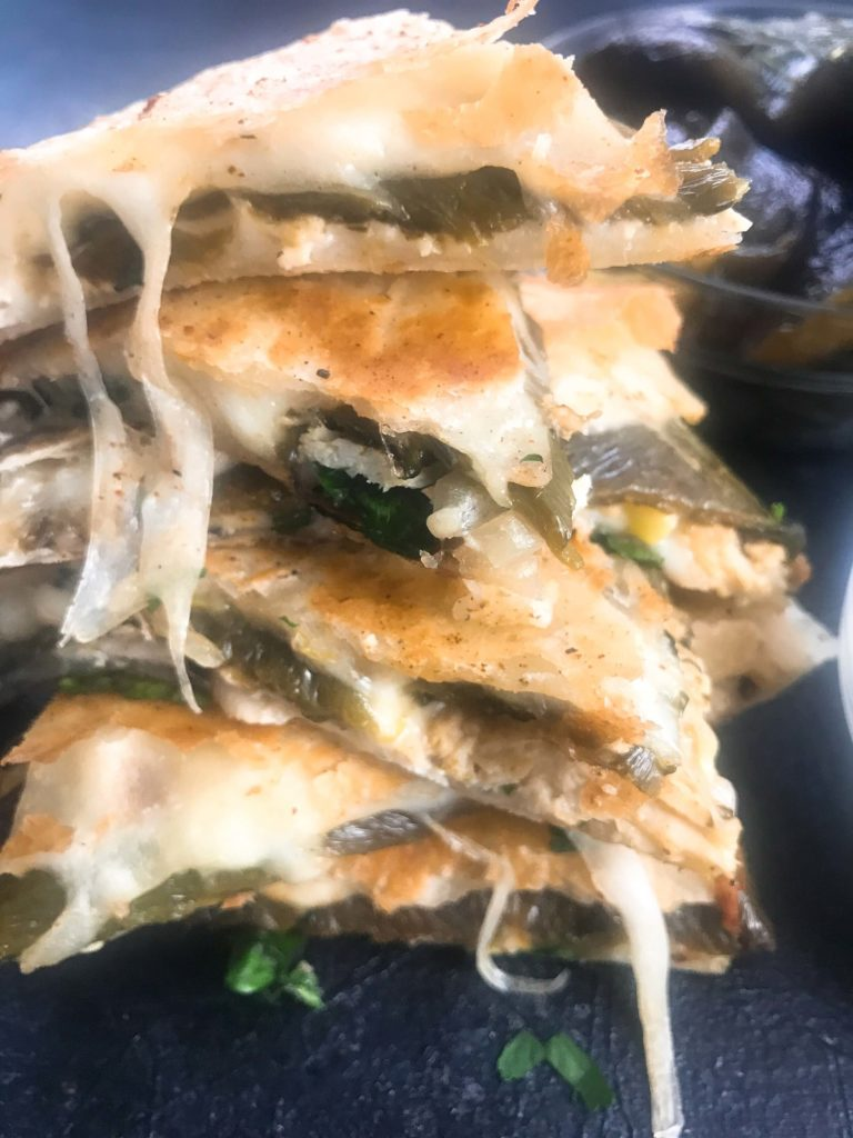 Chile relleno flavors of roasted poblano peppers and cheese layered in tortillas with chicken and vegetables. Quick and simple to make recipe as an appetizer, lunch, or meal. Chicken Chile Relleno Quesadilla | Three Olives Branch | www.threeolivesbranch.com #mexicanfood #cincodemayo
