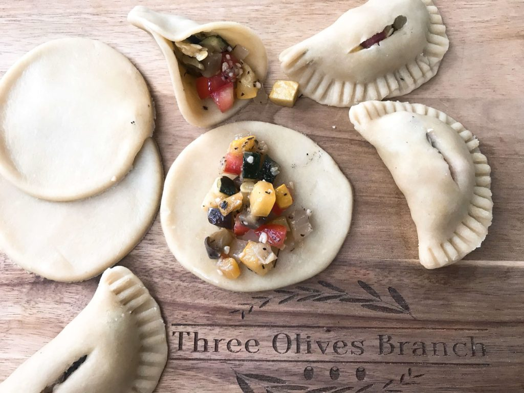 French inspired empanadas filled with eggplant, zucchini, squash, tomato, and onion. A great vegetarian recipe for party finger food or appetizers. Ratatouille Empanadas | Three Olives Branch | www.threeolivesbranch.com