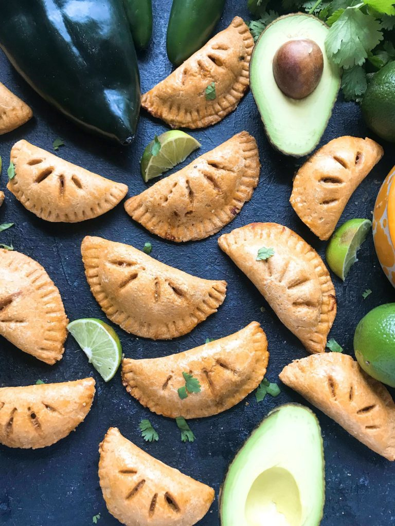 Empanadas stuffed with shredded beef and a Mexican Street Corn Salsa (elote) recipe of corn, cotija cheese, jalapeno, lime, chili powder, cilantro, and salt. A fun Mexican appetizer or snack. Use pie crust or make your own dough and leftover beef or steak if desired. Shredded Beef and Mexican Street Corn Empanadas | Three Olives Branch | www.threeolivesbranch.com #cincodemayo #fiesta