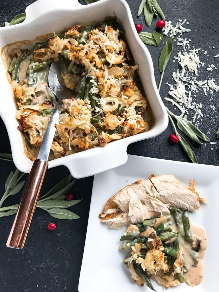 A twist on a classic holiday side dish. Parmesan and garlic enhance a homemade green bean casserole made from scratch. Make in advance for quick assembly on Christmas, Thanksgiving, Easter, or other holiday meals. Vegetarian. Parmesan Garlic Green Bean Casserole | Three Olives Branch | www.threeolivesbranch.com #thanksgivingrecipes #greenbeancasserole #holidayrecipes #christmasrecipes