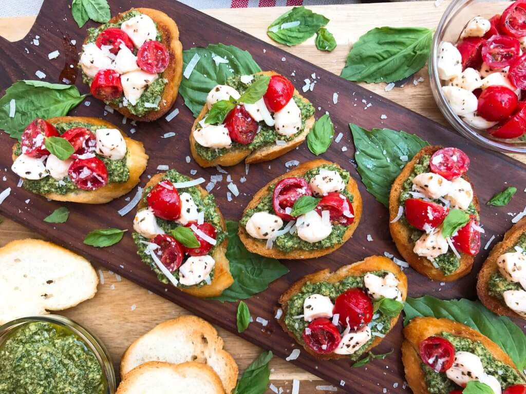 Tomato, mozzarella cheese, and pesto bread slices