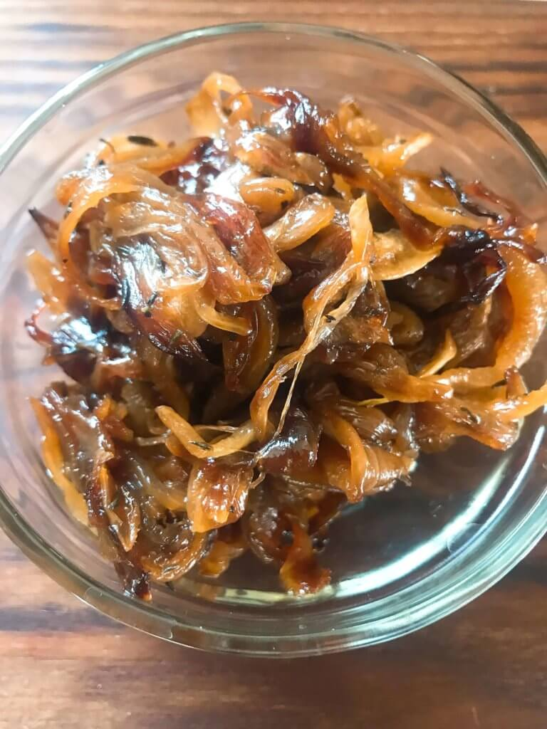 Learn How to Caramelize Onions. A simple recipe ready in 30 minutes, the onions are gluten free, vegan, vegetarian, paleo, and Whole 30. A perfect condiment to top on just about anything!