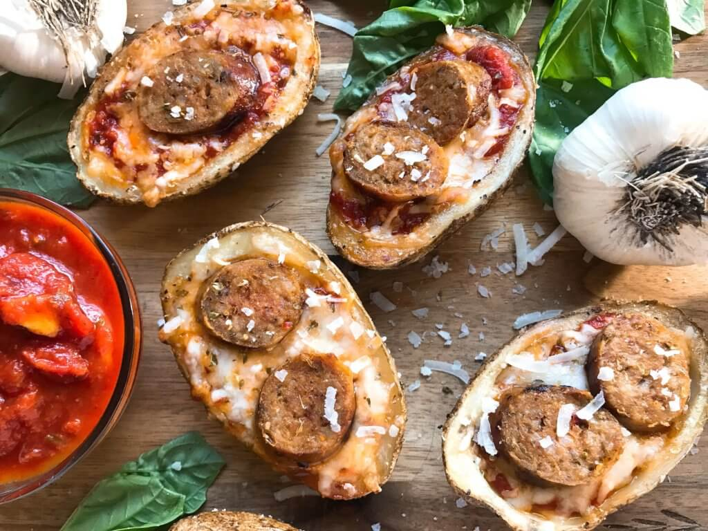 A simple and easy game day appetizer recipe. Italian Sausage Marinara Potato Skins are stuffed with marinara sauce, mozzarella, Parmesan cheese, and Italian sausage links. Delicious comfort food for parties and entertaining. Gluten free. #superbowlrecipes #gamedayrecipes #sausagerecipes #appetizers #glutenfreerecipes