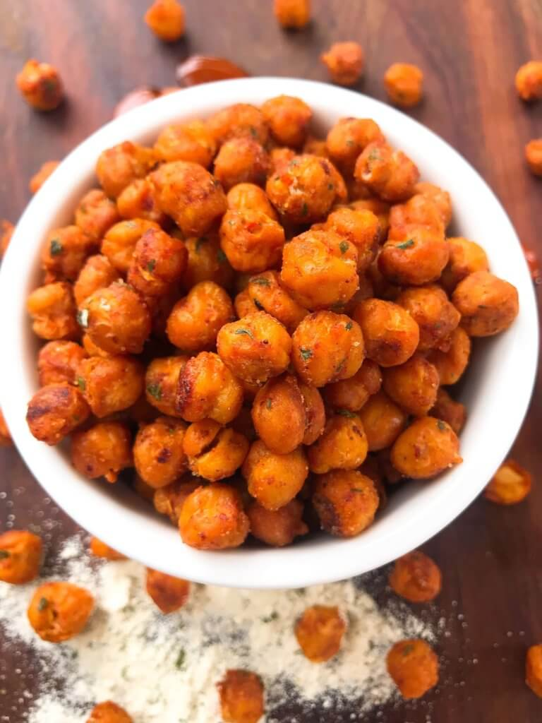 Simple, healthy, and easy game day snack recipe. Buffalo Ranch Roasted Chickpeas are crunchy garbanzo beans covered in buffalo wing sauce and ranch mix. Gluten free and vegetarian. #gamedayrecipes #buffaloranch #roastedchickpeas
