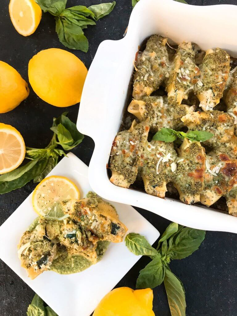 Fresh and bright flavors in a classic Italian dinner recipe. Zucchini Lemon Stuffed Shells with Creamy Pesto Sauce are stuffed with zucchini, lemon, ricotta, and Parmesan cheese. Topped with creamy basil pesto sauce. Vegetarian. #italianrecipes #stuffedshells #zucchinirecipes #pesto