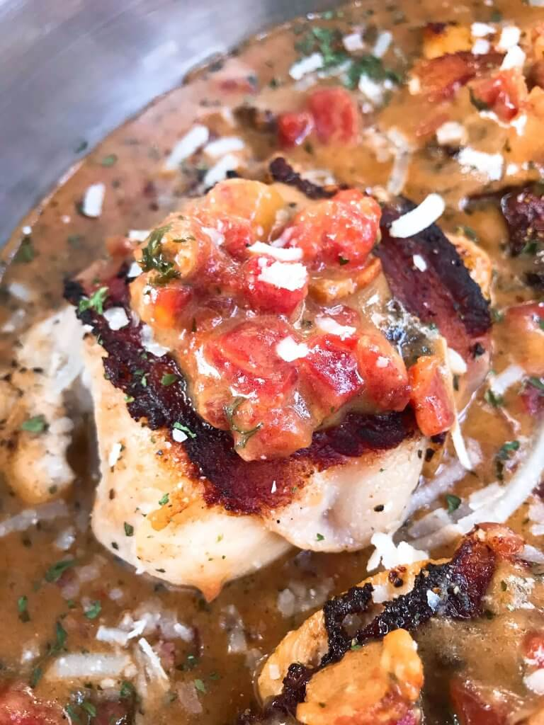 Skillet Bacon Wrapped Chicken in Tomato Bacon Parmesan Sauce is a gluten free one pot easy dinner. Make extra cheese sauce to spoon over vegetables, potatoes, or rice. Quick and simple meal. #chickendinner #baconchicken #onepotrecipe