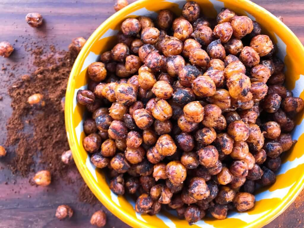 A healthy, vegan, dairy free, gluten free snack or party appetizer recipe. Healthy game day recipe. Simple and easy to make, Spicy Cocoa Espresso Roasted Chickpeas are coated in cayenne pepper, cocoa and coffee. #fingerfood #gamedayrecipes #healthysnacks