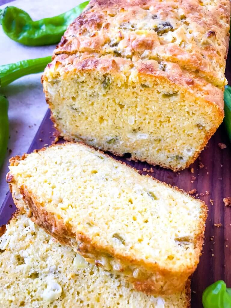 A loaf and slice of Hatch Green Chile Cheddar Cornbread