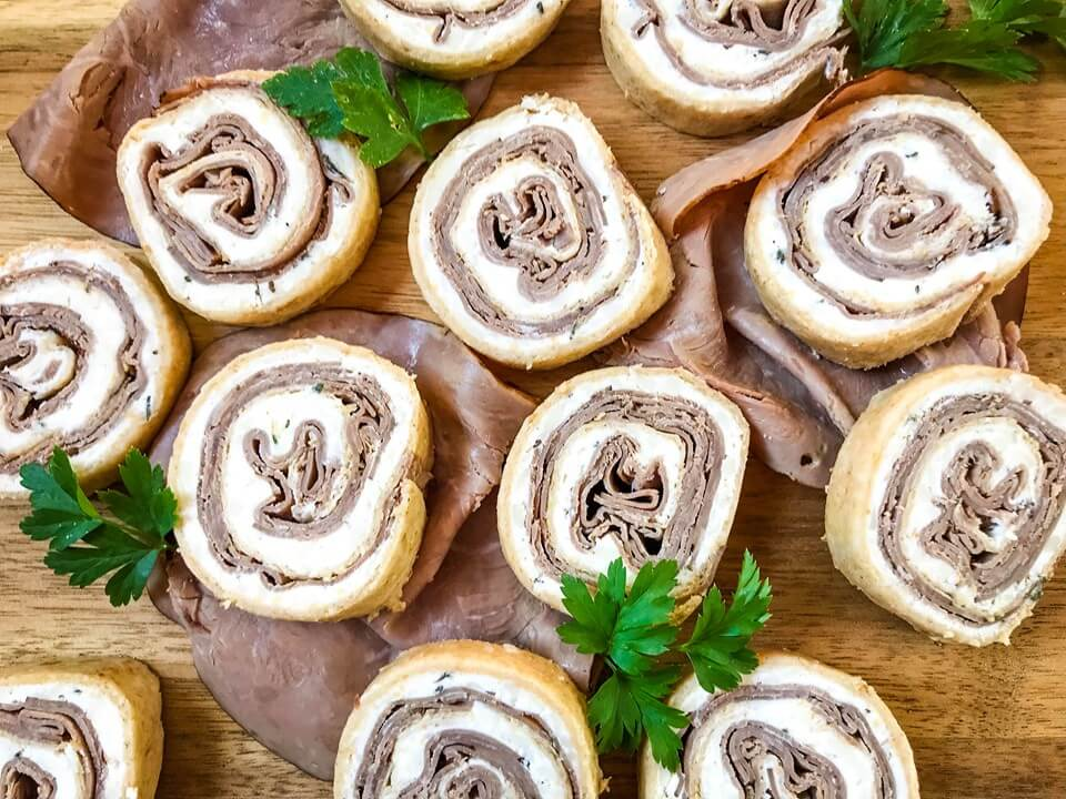 A fast and easy appetizer recipe ready in 20 minutes, Horseradish Roast Beef Pinwheels combine classic flavors in a party finger food. Roast beef is layered with a horseradish cream cheese mixture and rolled in flour tortillas. #gamedayrecipes #partyappetizers #holidayappetizers