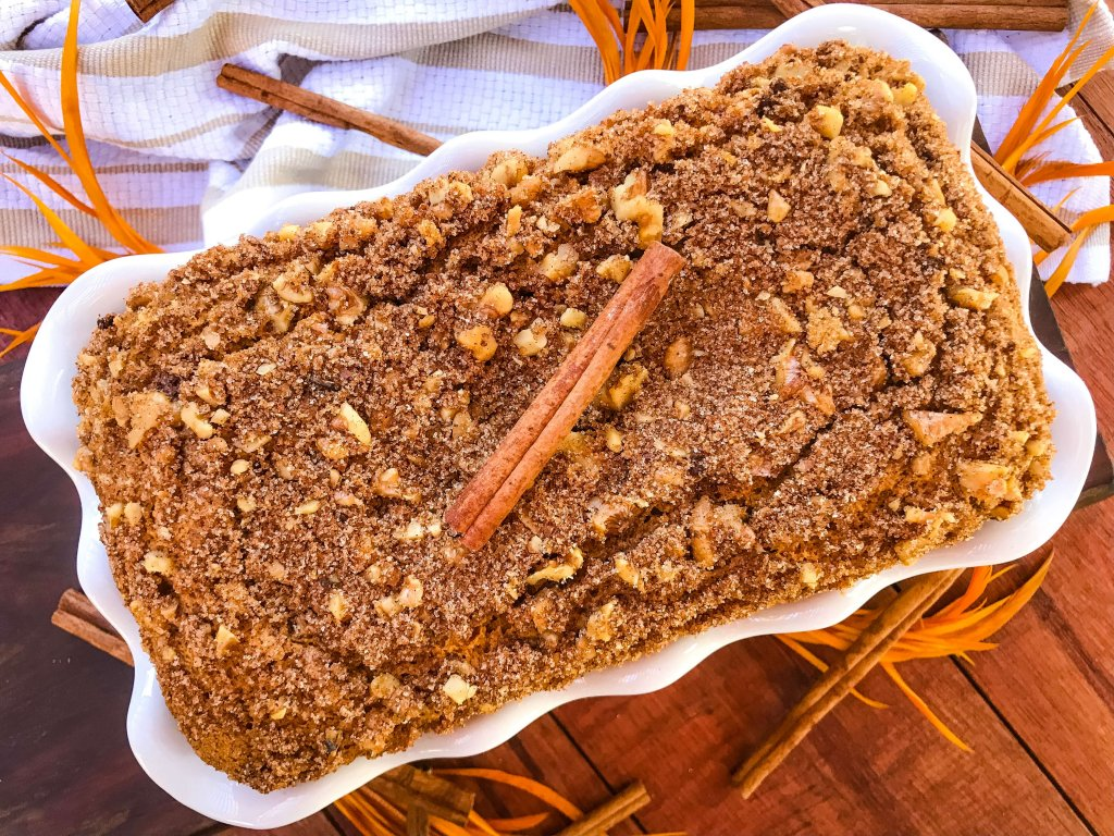 Full loaf of Cinnamon Streusel Pumpkin Bread in a white dish