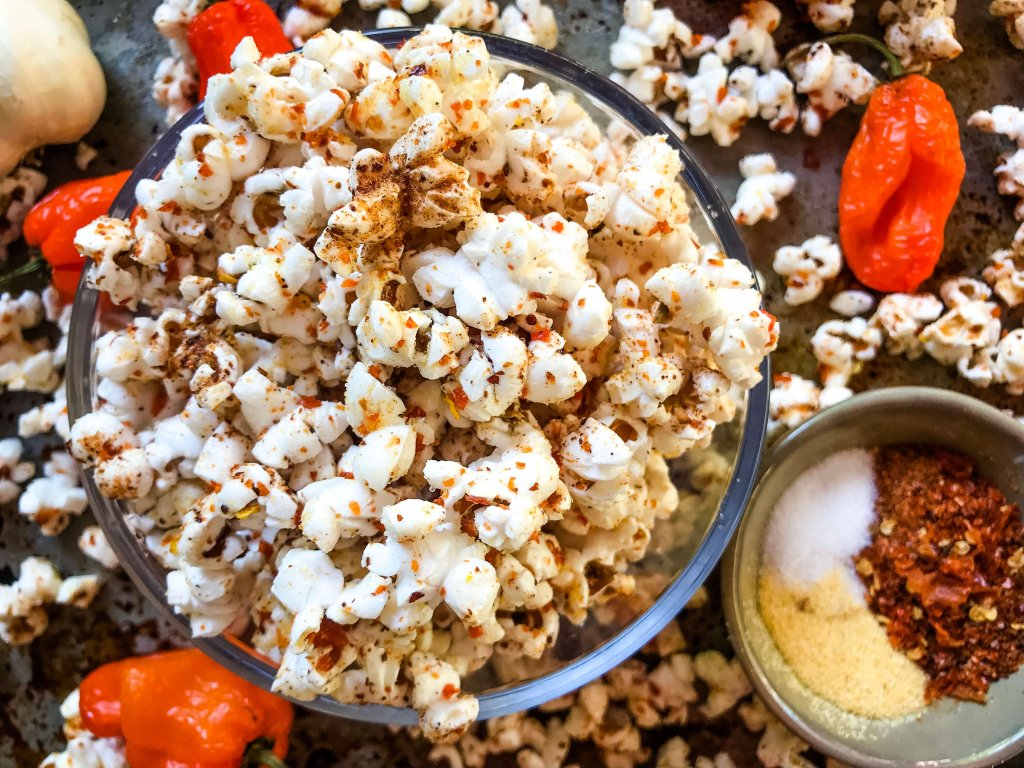 This Homemade Habanero Garlic Spicy Popcorn is a spicy snack recipe great for entertaining, party food, and game day. Vegan, vegetarian, gluten free. use any ground pepper with garlic powder and salt for a seasoning kick. #homemadepopcorn #spicyrecipe #spicyfood