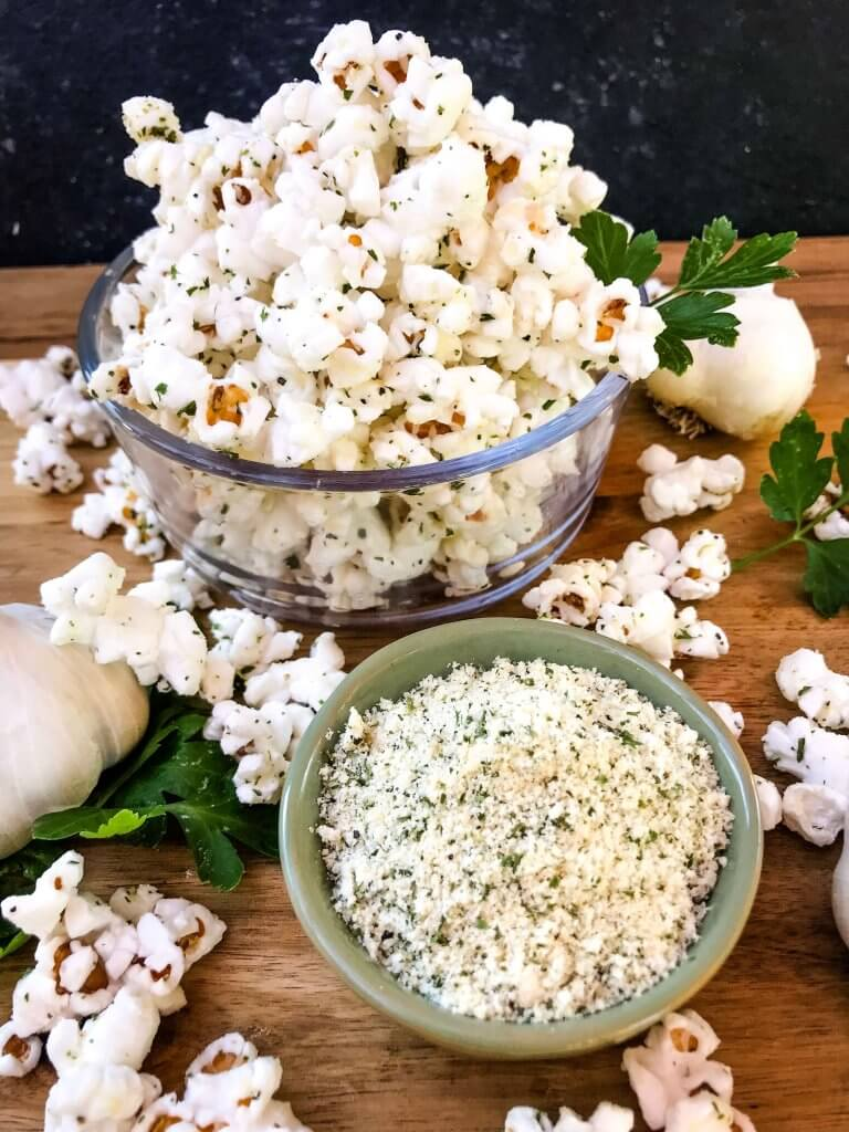 Ready in 10 minutes, Homemade Parmesan Garlic Popcorn is a fast and easy snack recipe. Parmesan cheese, garlic powder, and parsley season this healthy, gluten free, vegetarian appetizer. Great for party entertaining and game day. #homemadepopcorn #gamedayrecipes