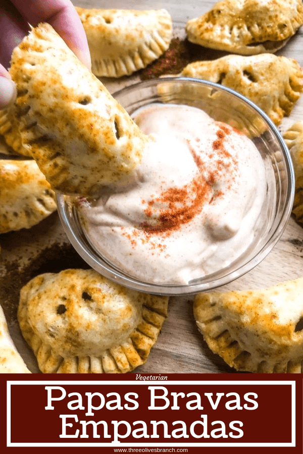 Patatas Bravas Empanadas are inspired by a Spanish tapas recipe. Roasted seasoned potatoes are stuffed in dough and served with a creamy paprika sauce. A great vegetarian appetizer recipe for party and entertaining food. #papasbravas #patatasbravas #spanishfood #appetizerrecipe