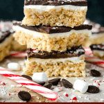 Pin image for Peppermint Bark Rice Krispie Treats stacked on each other with title