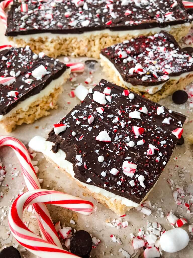 Peppermint Bark Rice Krispie Treats surrounded by candy cane pieces