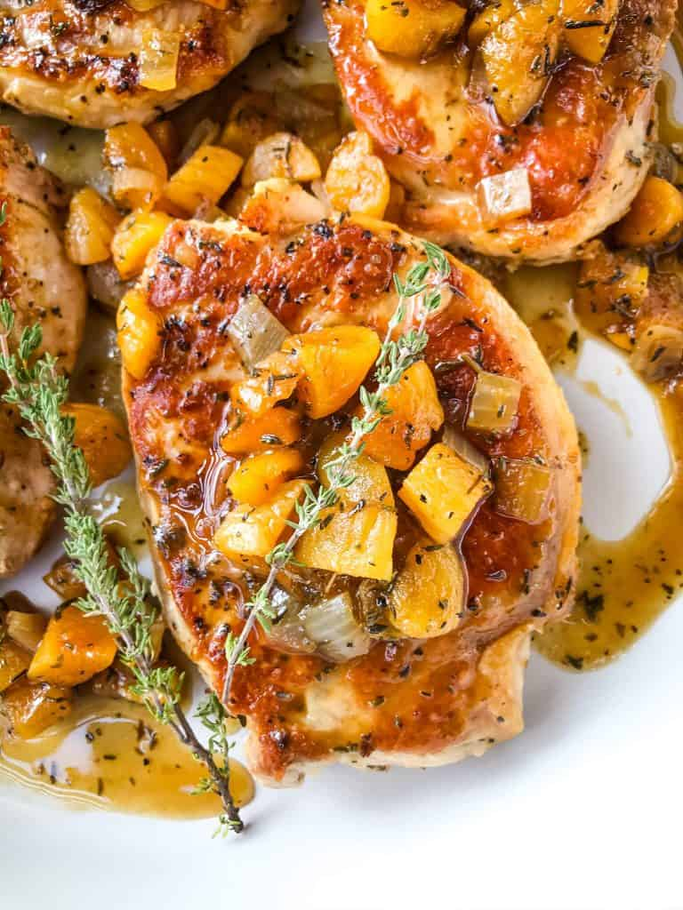 Stove top Bourbon Apricot Pork Chops recipe is a fast weeknight dinner made in one pot. A pan sauce of bourbon and dried apricots with seared pork served with rice, potatoes, or vegetables. Gluten free and dairy free, ready in 30 minutes. Easy pan seared pork chops. #porkchops #stovetopporkchops