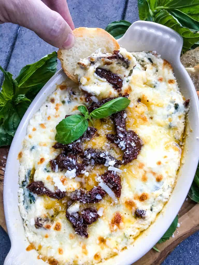 Tuscan Cheese Dip is an easy appetizer recipe. Three cheeses are melted and mixed with sun-dried tomatoes, spinach, and garlic. A cheesy Italian dip. #cheesedip #tuscan #italianrecipe