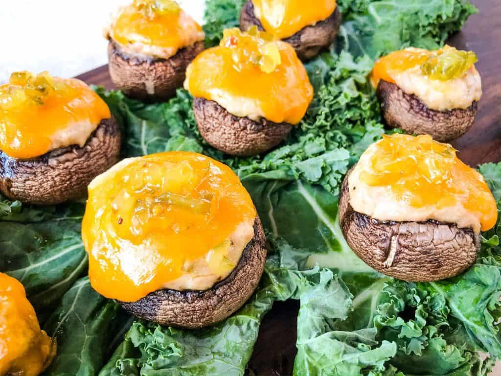 Tuna Melt Stuffed Mushrooms sitting on lettuce