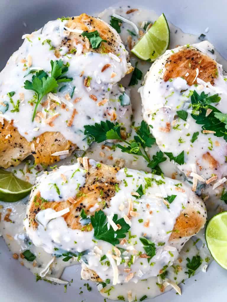 Coconut Lime Chicken is ready in 30 minutes! A skillet chicken recipe with a quick coconut lime pan sauce. Dairy free, gluten free, and keto low carb. Fast easy chicken dinner. #chickenrecipes #30minutemeals #coconutchicken