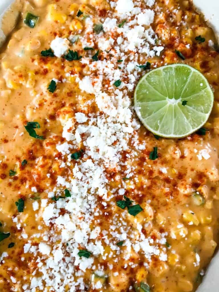 Mexican Street Corn Elote Creamed Corn is a simple homemade creamed corn recipe perfect for a Mexican, BBQ or Southern soul food meal. Corn is cooked with jalapeno, chili powder, lime, milk, and butter for a simple side dish. #creamedcorn #elote #mexicanstreetcorn