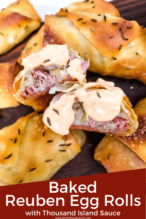 Pin image for Baked Reuben Egg Rolls with Thousand Island Sauce with an egg roll cut open showing corn beef and sauerkraut with sauce on it and title at bottom