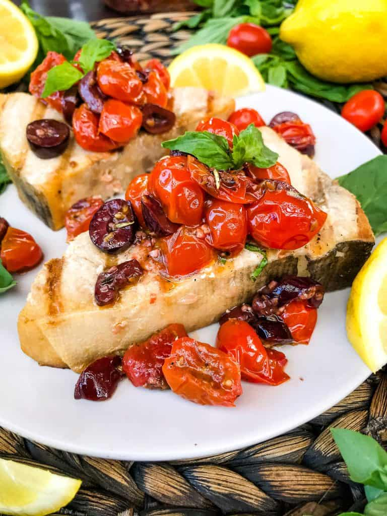Grilled Swordfish Steaks with Tomato Olive Relish on a plate
