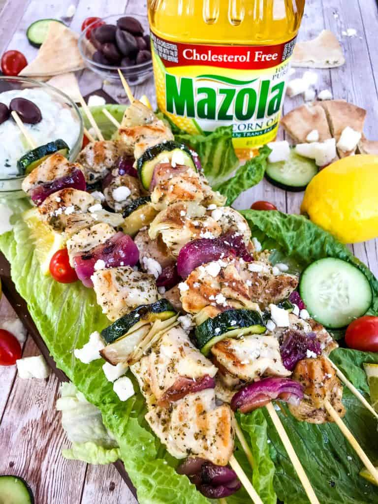 Fresh and Light Grilled Greek Chicken Skewers are a quick chicken grilling recipe for the BBQ! Chicken marinated in oil, oregano, and lemon on a kebab with onion, artichoke, and fresh Greek ingredients. Fast chicken kabob on the grill. #grilledchicken #chickenkabobs #greekchicken