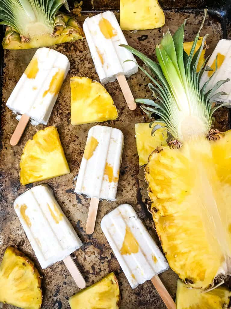 Pina Colada Popsicles are easy and healthy homemade popsicles made with coconut milk and pineapple. Add rum if desired for an alcohol popsicle poptail. Gluten free and vegan. #homemadepopsicles #pinacolada #coconutpopsicles