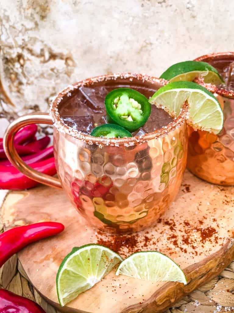 Spicy Mexican Mule Cocktail recipe is a twist on the classic drink using tequila instead of vodka with ginger beer, lime, and heat with a salt rim. A simple and delicious Moscow Mule variation. #mexicanmule #tequilacocktail #moscowmule #spicycocktail