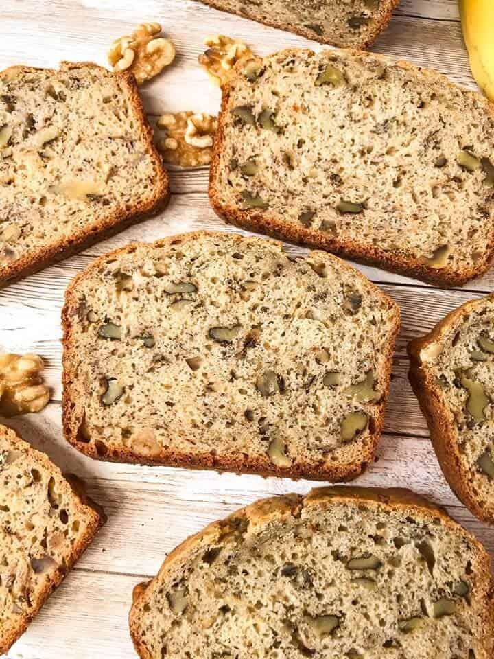 Slices of easy banana bread spread out on wood planks