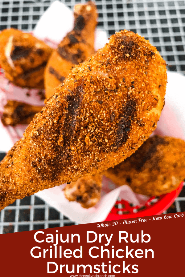 Pin image of Dry Rub Cajun Grilled Chicken Drumsticks with a close up of a grilled chicken drumstick with grill lines