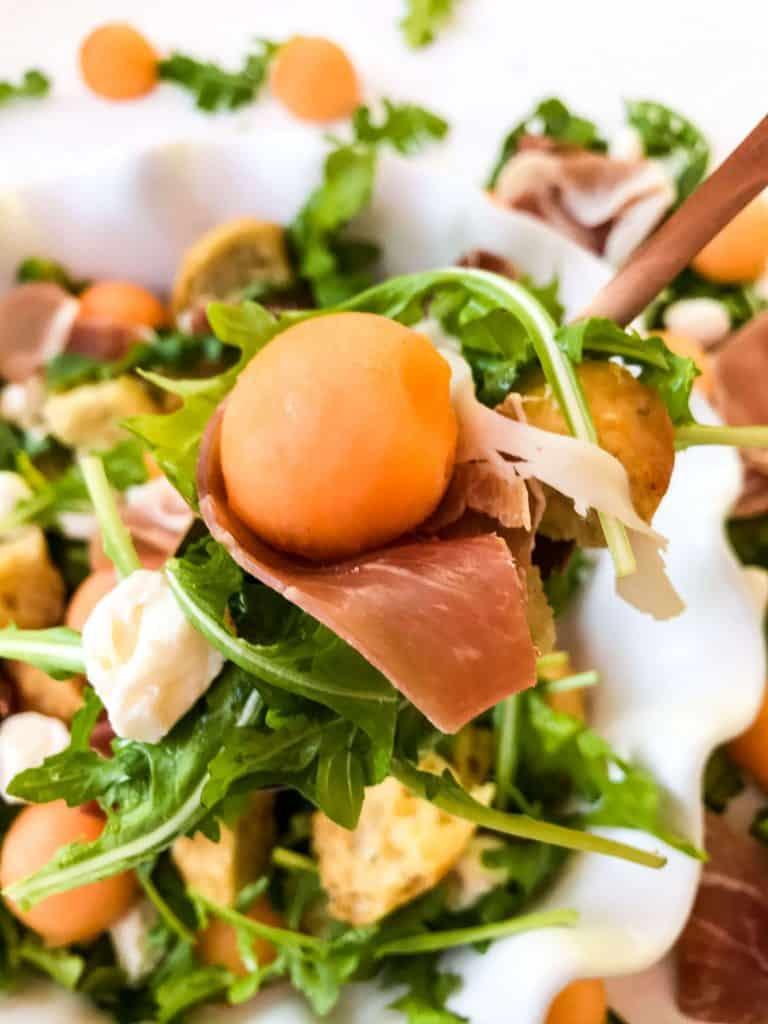 Spoon full of Prosciutto Melon Panzanella Salad