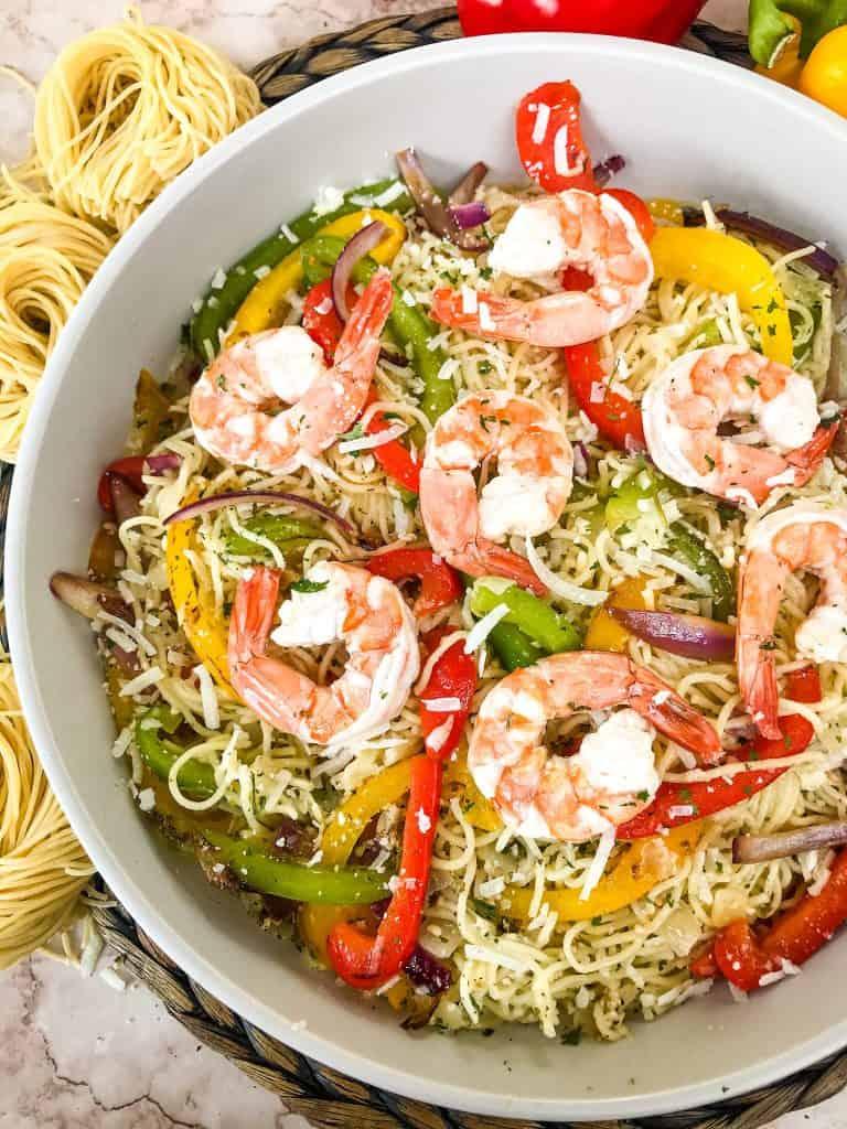 Most of a bowl of Copycat Olive Garden Shrimp Scampi
