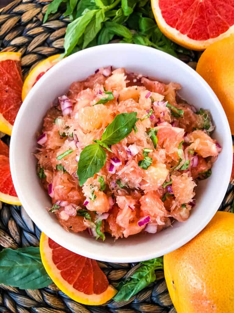 A white bowl filled with Grapefruit Basil Relish