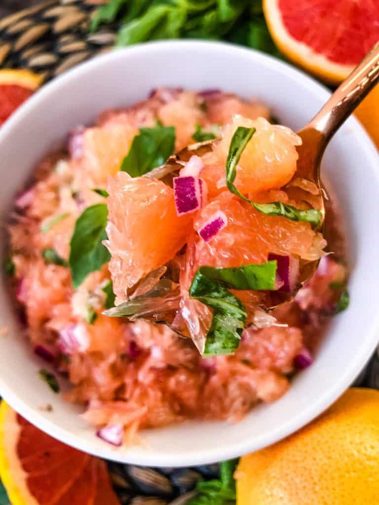 A copper spoon of grapefruit basil salsa