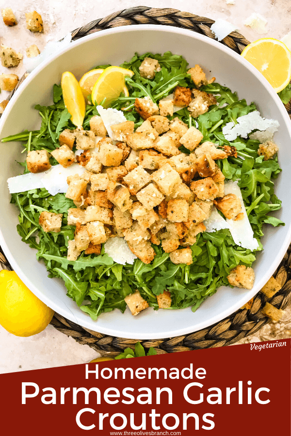 Pim image of Homemade Parmesan Garlic Croutons on lettuce in bowl with title at bottom