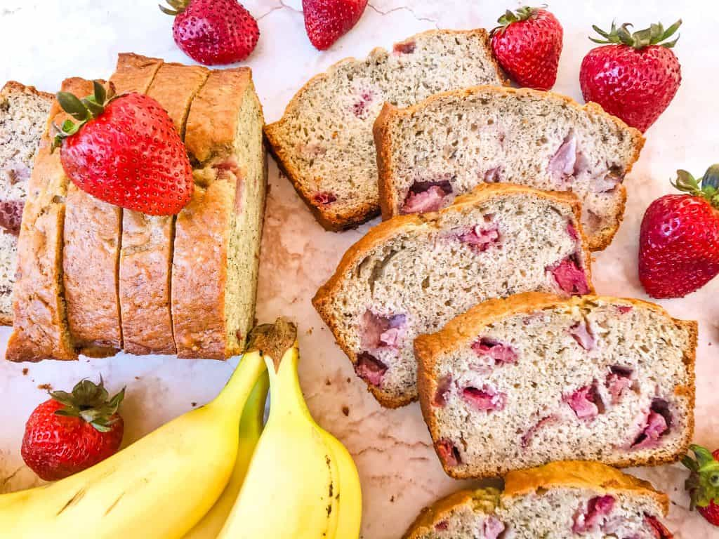 Many slices of banana bread with strawberries