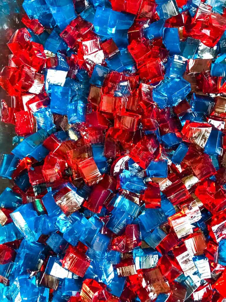 Red and blue jello cubes mixed together