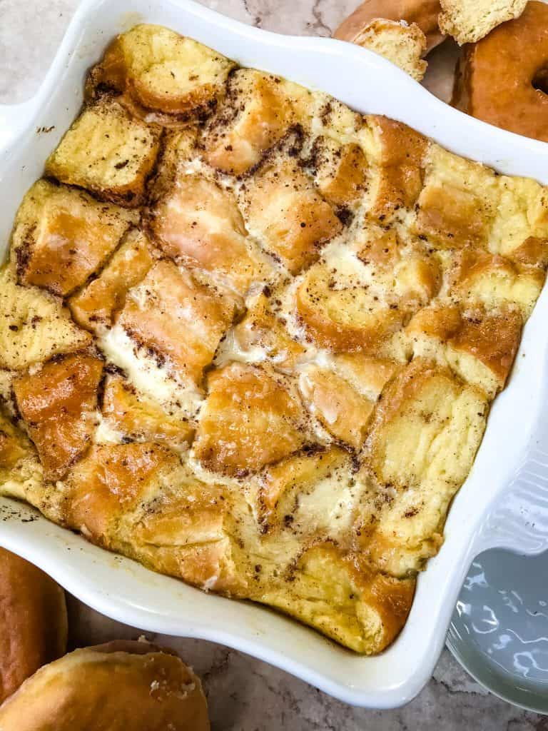 White dish filled with Doughnut Bread Pudding