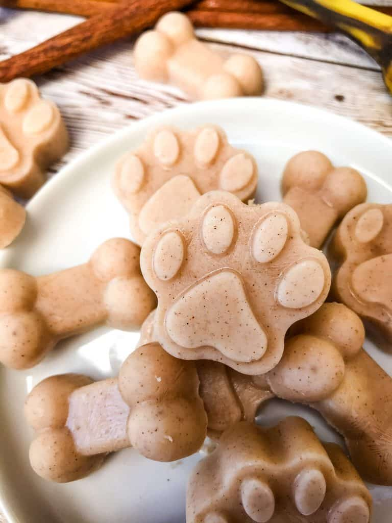 Close up of paw shaped Frozen Cinnamon Banana Dog Treat