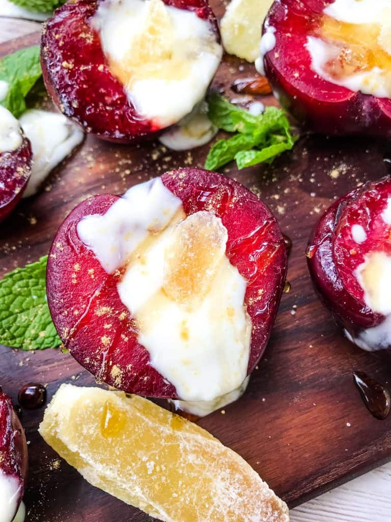 A close up of Grilled Plum Dessert with Ginger Honey Yogurt