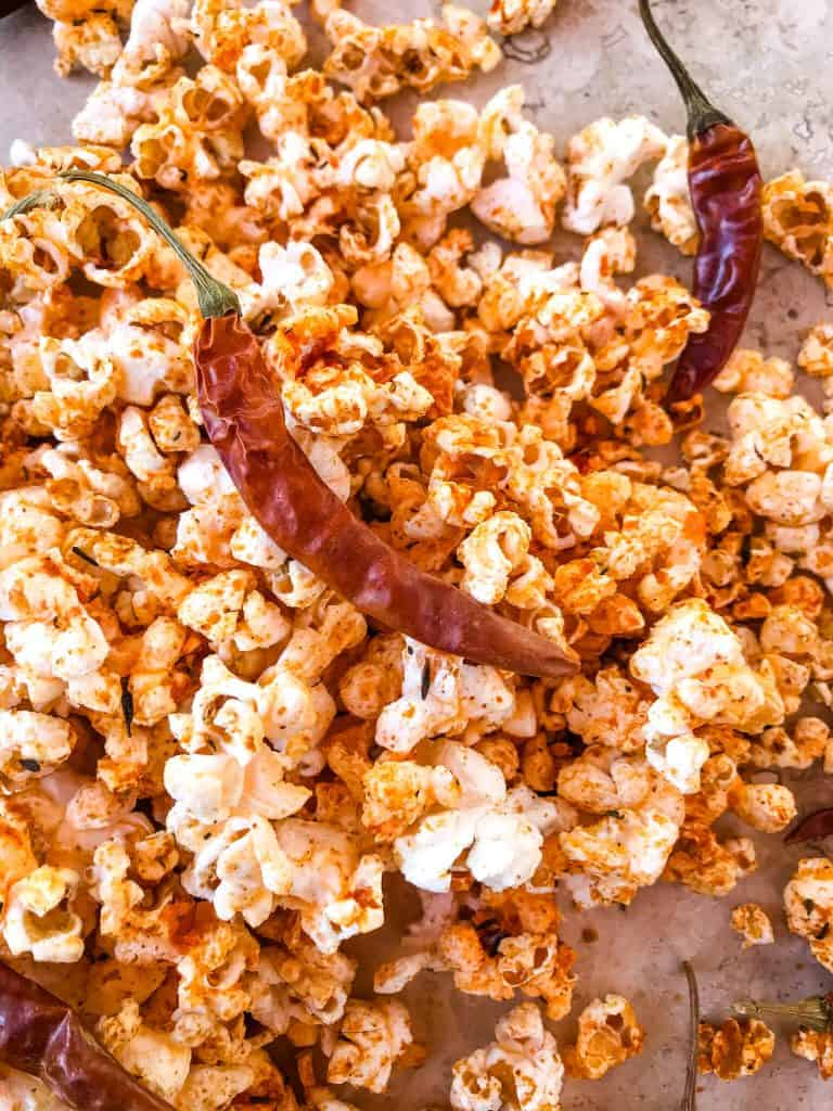 A pile of popcorn with a pepper