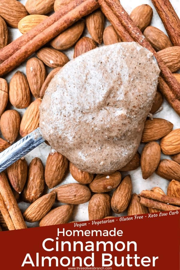 Pin image of Homemade Cinnamon Almond Butter on a spoon on top of almonds with title at bottom